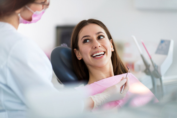 Woman smiling in a dental chair at Michael Yokoyama, DDS in Encinitas, CA
